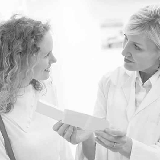 Female clinician counseling female patient